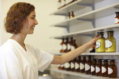 Pharmacist taking bottle Royalty Free Stock Photos