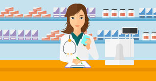 Pharmacist taking notes. Stock Photos