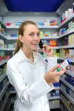 Pharmacist talking on phone. At the pharmacy royalty free stock photography