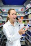 Pharmacist talking on phone Royalty Free Stock Photography