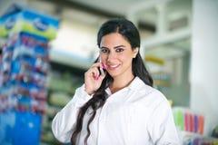 Pharmacist talking on the phone Stock Photo