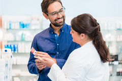 Pharmacist talking to customer in drug store royalty free stock photos