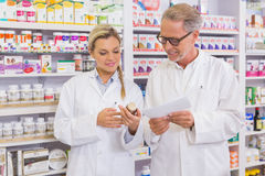 Pharmacist and trainee talking together about medication Stock Image