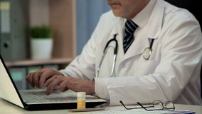 Pharmacist typing on laptop research about new drugs, medicine development. Stock photo royalty free stock photography
