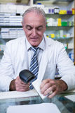 Pharmacist using barcode scanner on medicine box Stock Images