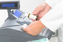 Pharmacist using cash register Stock Image