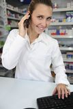 Pharmacist using computer Stock Images