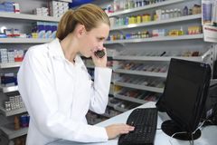 Pharmacist using computer Stock Photos