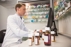 Pharmacist using computer at desk Royalty Free Stock Photo