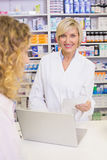 Pharmacist using the computer Stock Images