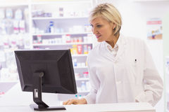Pharmacist using the computer Royalty Free Stock Photo