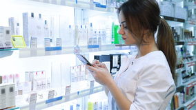 Pharmacist using a digital tablet
