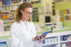 Pharmacist using tablet pc Stock Images