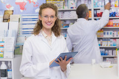 Pharmacist using tablet pc Stock Photography