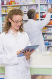 Pharmacist using tablet pc Royalty Free Stock Image