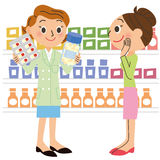 Pharmacist and visitor Stock Photography