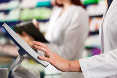 Free Pharmacist With Assistant In Pharmacy Royalty Free Stock Photo - 21337895