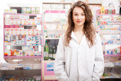 Pharmacist woman in front of her desk at work stock images