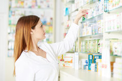 Pharmacist woman picking medicine Stock Photos