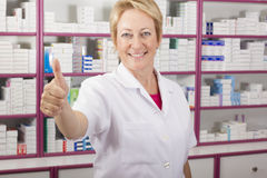 Pharmacist Women. Pharmacist Woman Thumbs Up and smiling stock images