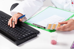Pharmacist during work in pharmacy stock photography