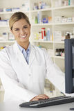 Pharmacist working on computer in pharmacy Royalty Free Stock Images
