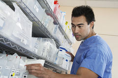 Pharmacist Working At Drug Store Royalty Free Stock Photography