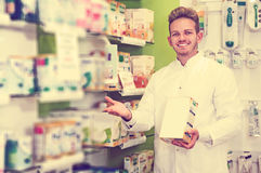 Pharmacist working in pharmaceutical shop Royalty Free Stock Photo