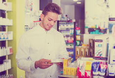 Pharmacist working in pharmaceutical shop Stock Photos