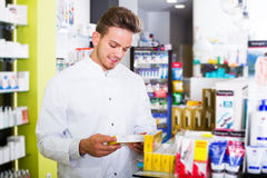 Pharmacist working in pharmaceutical shop Stock Photography