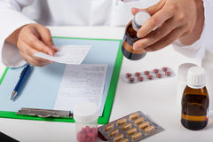 Pharmacist working in pharmacy Stock Images