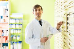 Pharmacist working in pharmacy. Portrait of male pharmacists working in warehouse depot Royalty Free Stock Image