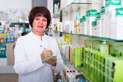 Pharmacist working in shop Stock Images