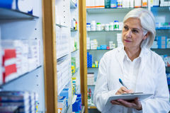 Pharmacist writing on clipboard Stock Image