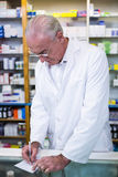 Pharmacist writing prescriptions for medicines Stock Images