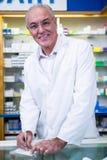 Pharmacist writing prescriptions for medicines Stock Image