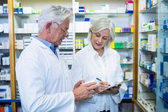 Pharmacists checking and writing prescription for medicine Stock Photo