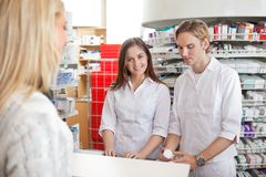 Pharmacists with Female Customer Stock Image