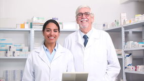 Pharmacists looking at camera Royalty Free Stock Images