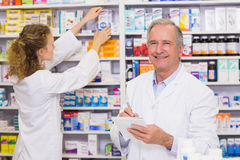 Pharmacists searching medicines with prescription Royalty Free Stock Photography