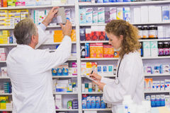 Pharmacists searching medicines with prescription Stock Photo