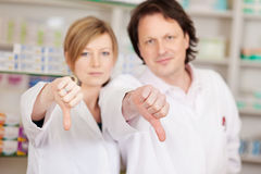 Pharmacists showing thumbs down Stock Photography