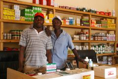 Pharmacists in a small rural pharmacy selling medical products stock photography
