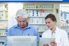 Pharmacists using digital tablet and computer Stock Photo