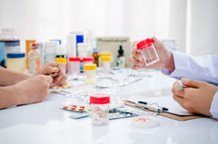 Pharmacists working in office Stock Photography