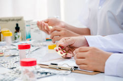 Pharmacists working in office Stock Images