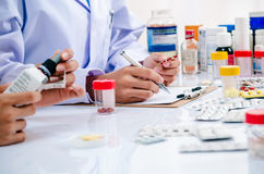 Pharmacists working in office Royalty Free Stock Photography