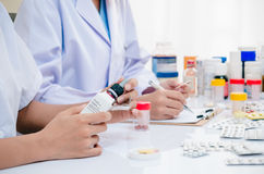 Pharmacists working in office Stock Photos