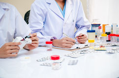 Pharmacists working in office Royalty Free Stock Photos