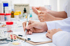 Pharmacists working in office Royalty Free Stock Photo
